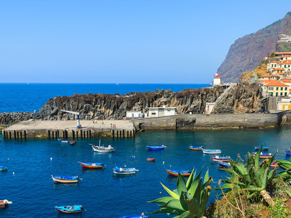 Colorful-fishing-boats-on-sea-water-in-Camara-de-Lobos