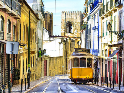Romantic-Lisbon-street-with-the-typical-yellow-tram