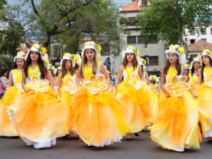 FUNCHAL, MADEIRA - APRIL 20, 2015 Young girls dancing in the Madeira Flower Festival, Funchal, Portugal