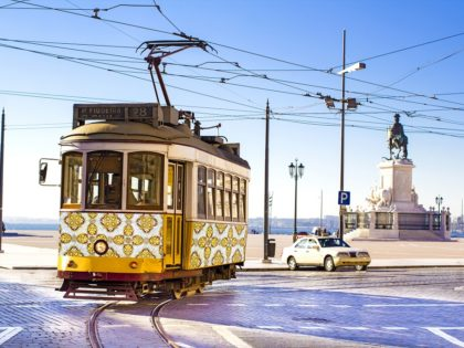 Vintage yellow tramway at the Commerce Square in Lisbon